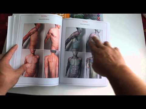"""Uldis Zarins opening the book """"Anatomy For Sculptors"""" for very first time."""